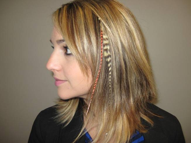 Diana Filipescu models her feather hair extensions at the Greenspun Media Group building on October 21, 2011.