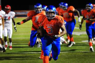 Bishop Gorman running back Shaquille Powell charges into the end zone during their game against Arbor View Friday, October 21, 2011. Gorman won their homecoming game 56-7.