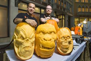 Pumpkin artists Ray Villafane and Andy Bergholtz pose during a pumpkin-carving exhibition in the Grand Canal Shoppes at the Venetian on Wednesday, Oct. 26, 2011. The pumpkins will be displayed at Heidi Klum's Halloween party and other Halloween events at Tao and Lavo.