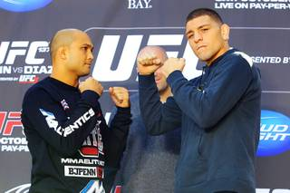 B.J. Penn and Nick Diaz face off during a news conference in advance of UFC 137 Thursday, Oct. 27, 2011.