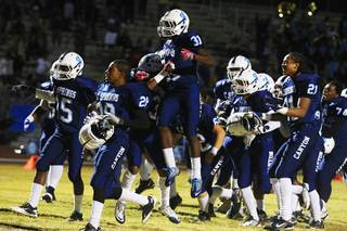Canyon Springs players celebrate after making a two point conversion in overtime against Las Vegas during their game Thursday, Oct. 27, 2011. Canyon Springs won the game 22-21.