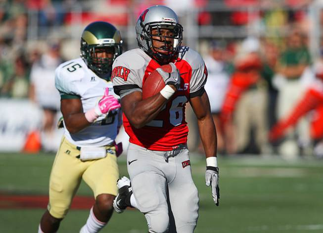 UNLV's Deante' Purvis outruns Colorado State's Marcus Shaw on the way to a 98-yard kickoff return for a touchdown Saturday at Sam Boyd Stadium on Saturday, Oct. 29, 2011.