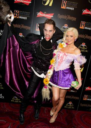 Holly Madison, with co-star Josh Strickland, hosts her annual Hollyween Party at Studio 54 in MGM Grand on Oct. 29, 2011.