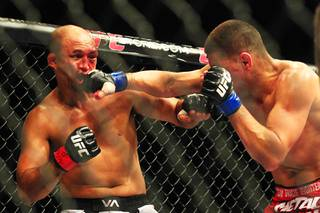 Nick Diaz hits B.J. Penn with a right during their bout at UFC 137 on Saturday, Oct. 29, 2011, at Mandalay Bay Events Center. Diaz won by unanimous decision, and Penn announced his retirement after the fight.