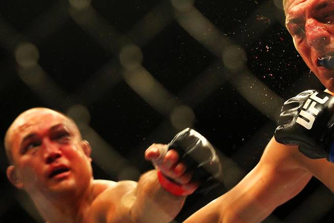 B.J. Penn hits Nick Diaz with a left during their bout at UFC 137 on Saturday, Oct. 29, 2011, at the Mandalay Bay Events Center. Diaz won by unanimous decision, and Penn announced his retirement after the fight.