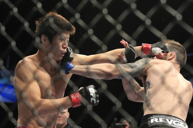 George Roop lands a left to the head of Hatsu Hioki during their bout at UFC 137 Saturday, Oct. 29, 2011 at the Mandalay Bay Events Center. Hioki won by split decision.