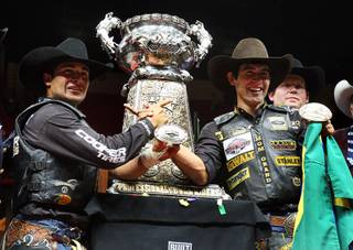 Brazilian bull riders Robson Palermo, left, and  Silvano Alves celebrate during the Professional Bull Riders World Finals at the Thomas and Mack Center Sunday, Oct. 30, 2011. Palermo won the Las Vegas event and $250,000. Alves won the series championship and $1 million.