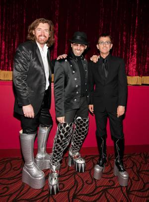 "Cast members of ""The Australian Bee Gees Show"" in KISS boots."