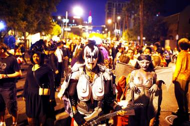 Gary Downe of Las Vegas, dressed in a homemade costume as Gene Simmons of KISS, walks in the Las Vegas Halloween Parade in downtown Las Vegas on Monday, Oct. 31, 2011.
