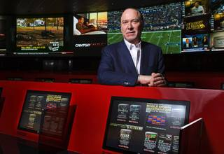 Lee Amaitis, CEO of Cantor Gaming, poses in the remodeled race and sports book in the Venetian on Tuesday, Nov. 1, 2011. The sports book reopened after a three-month, multimillion-dollar renovation.