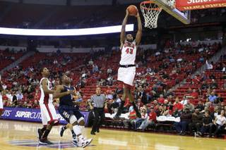 UNLV forward Mike Moser dunks the ball during the closing minute of their game against Washburn Tuesday, Nov. 1, 2011. UNLV won the exhibition game 58-50.