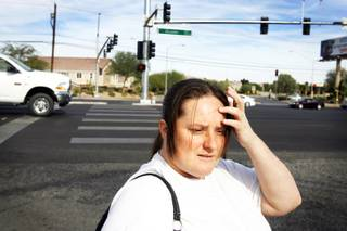 Latacsha Paniza waits to cross Tropicana Avenue at Boulder Highway in Las Vegas Thursday, November 3, 2011.