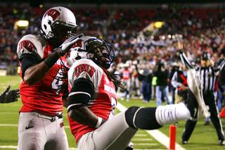UNLV wide receivers Michael Johnson, right, and Phillip Payne celebrate Johnson's touchdown against Boise State during their Mountain West Conference game Saturday, Nov. 5, 2011 at Sam Boyd Stadium.