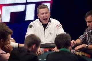 Ben Lamb of Las Vegas yawns as he competes during the 2011 World Series of Poker Main Event final table at the Rio Sunday, Nov. 6, 2011.
