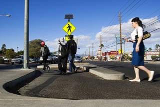 Pedestrians use a Danish offset as they cross Maryland Parkway near UNLV Monday, October 7, 2011.  A Danish offset is in the median area where the crosswalk makes an S turn, slowing pedestrians down and making them look at traffic before they cross.