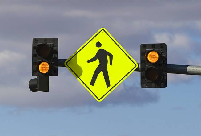 Overhead flashers, operated manually with a button when pedestrians want to cross, are shown over Maryland Parkway by the Boulevard Mall Monday, October 7, 2011.
