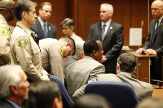 Dr. Conrad Murray is remanded into custody after a jury returned with a guilty verdict in his involuntary manslaughter trial Monday, Nov. 7, 2011, in a Los Angeles courtroom. Murray was convicted in a trial that painted him as a reckless caregiver who administered a lethal dose of a powerful anesthetic that killed Michael Jackson.