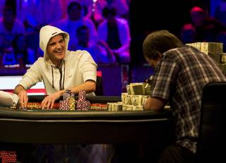 Pius Heinz, left, of Germany smiles as he competes heads up against Martin Staszko of the Czech Republic during the World Series of Poker Main Event at the Rio on Tuesday, Nov. 8, 2011.