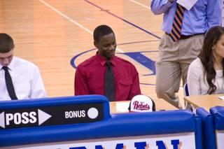 Bishop Gorman High senior Demetris Morant signs his national letter of intent with UNLV on Wednesday, Nov. 9, 2011.