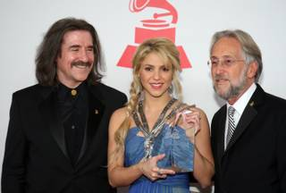 Honoree Shakira, center, poses with Luis Cobos, left, Chairman of the Latin Recording Academy, and  Neil Portnow, National Academy of Recording Arts and Sciences (NARAS) President/CEO, at the 2011 Latin Recording Academy's Person of the Year tribute dinner and concert at the Mandalay Bay Wednesday, November 9, 2011.