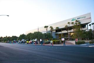 Occupy Las Vegas demonstrates in front of NV Energy, speaking out against rate increases, Wednesday Nov. 9, 2011