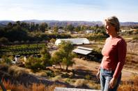 Farm owner Laura Bledsoe stands with Quail Hollow Farm in the background in Overton on Wednesday, Nov. 9, 2011.