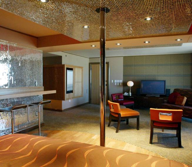 A view of a bachelor suite at the Palms, complete with stripper pole.