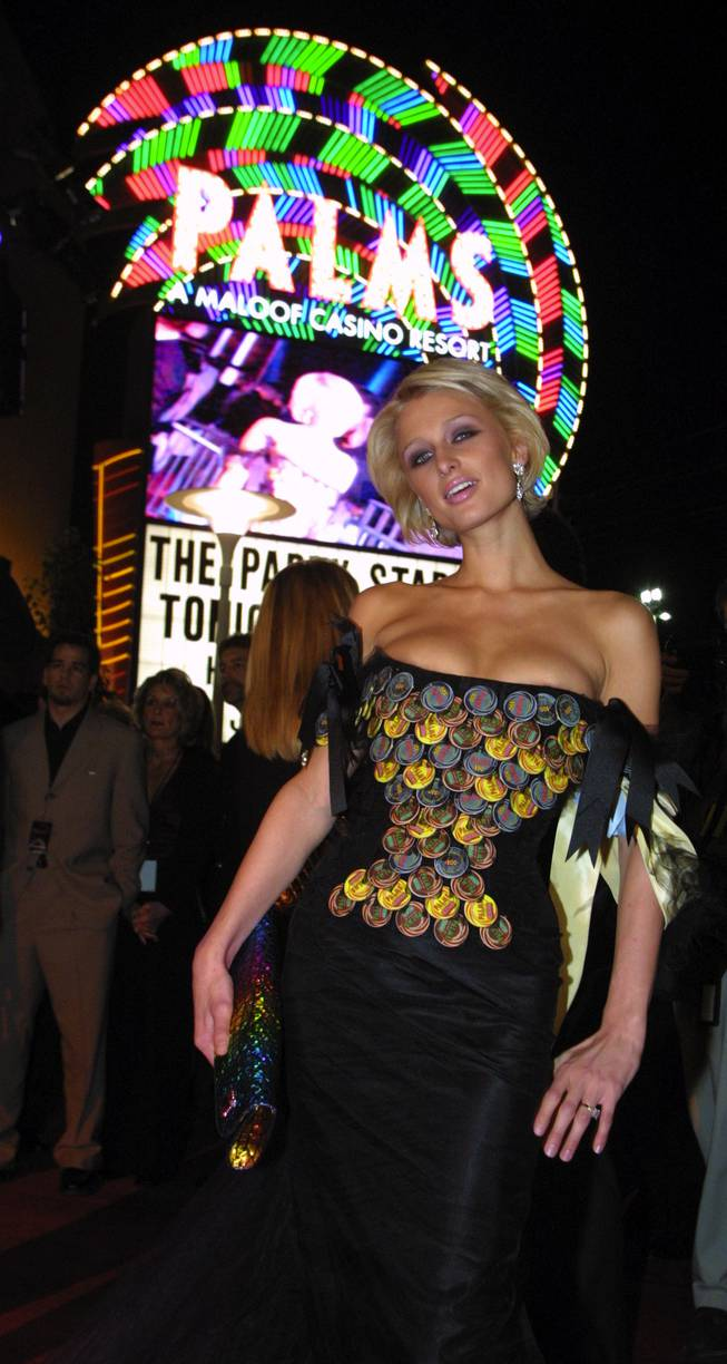 Paris Hilton arrives at the opening of the Palms in a $1 million dollar dress made of casino chips on November 15, 2001.