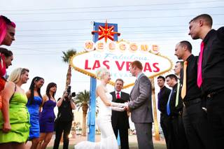 Ashley Hankinson and Jeremy Hankinson of Brantford, Ontario, wed at the Welcome to Fabulous Las Vegas sign on Friday, Nov. 11, 2011.