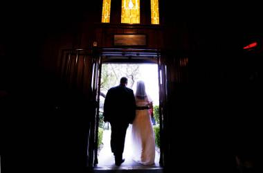 Jim Beck of Ohio and Shannon Steinfact of New Mexico walk out of the chapel as a married couple at Little Church of the West in Las Vegas Friday November 11, 2011.