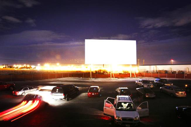 Cars pull in to watch a movie at the West Wind Drive-In movie theatre in North Las Vegas Friday November 11, 2011.