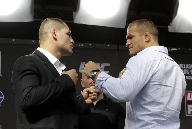 Cain Velasquez and Junior dos Santos square off in a press event this week in Los Angeles. Velasquez and dos Santos fight for the UFC heavyweight title Saturday, Nov. 12, 2011, in Anaheim, Calif.