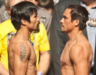 Manny Pacquiao and Juan Manuel Marquez's weigh-in at MGM Grand Garden Arena on Nov. 11, 2011.