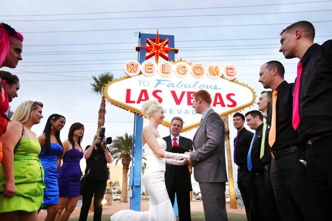 Ashley Hankinson and Jeremy Hankinson of Brantford, Ontario, get married at the Welcome to Fabulous Las Vegas sign on Friday, Nov. 11, 2011.
