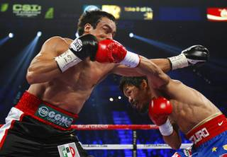 Juan Manuel Marquez, left, of Mexico battles it out with Manny Pacquiao of the Philippines during their WBO welterweight fight at the MGM Grand Garden Arena Saturday Nov. 12, 2011.