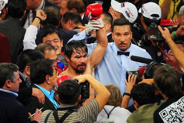 Manny Pacquiao entered tonight's WBO World Welterweight title bout against Juan Manuel Marquez as a prohibitive favorite, by sports bettors and thousands of Filipinos at MGM Grand Garden Arena.