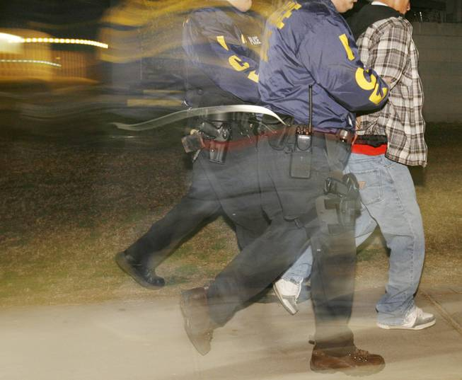 Immigration and Customs Enforcement officers arrest a suspected illegal immigrant in Santa Ana, Calif., in this 2007 file photo.