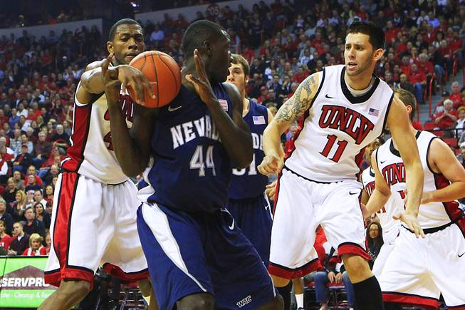 UNLV forward Mike Moser swats the ball away from Nevada-Reno forward Dario Hunt during their game Monday, Nov. 14, 2011 at the Thomas & Mack Center.