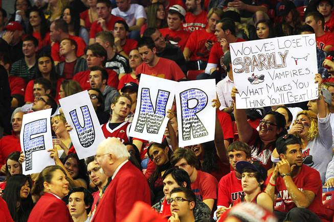 UNLV fans hold up signs during their game against Nevada-Reno Monday, Nov. 14, 2011 at the Thomas & Mack Center. UNLV won the game 71-67.