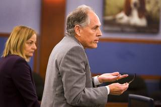 Richard Wright, attorney for Dr. Dipak Desai, speaks to District Court Judge Kathleen Delaney at the Regional Justice Center Tuesday, November 15, 2011. At left is attorney Margaret Stanish. Judge Delaney set a Jan. 27 hearing date for the defense to challenge a competency finding.