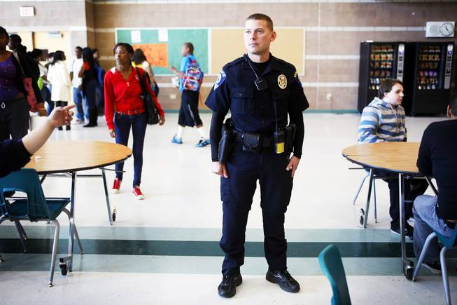Clark County School District Police officer John Maier watches students during lunch inside the cafeteria at Mojave High School in North Las Vegas on Thursday, Nov. 17, 2011.