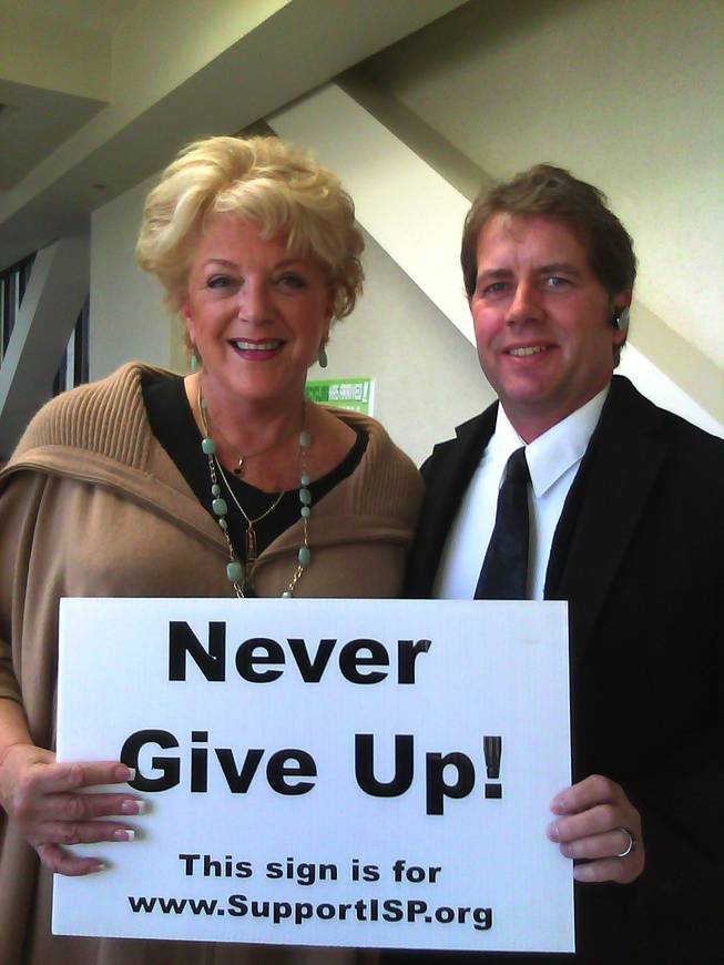 Las Vegas Mayor Carolyn Goodman poses with Matthew Dovel, president of International Suicide Prevention, a nonprofit group that offers counseling services, as well as suicide scene cleanups.