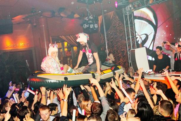 Holly Madison and DJ Steve Aoki surf the crowd at Surrender on Nov. 18, 2011.