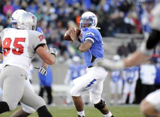 Air Force quarterback Tim Jefferson Jr. (7) controls the ball against UNLV in the first half of an NCAA college football game at Falcon Stadium in Air Force Academy, Colo., Saturday, Nov. 19, 2011.