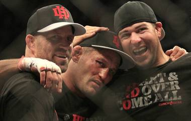 Dan Henderson, center, celebrates with teammates after beating Mauricio Rua during a UFC 139 Mixed Martial Arts light heavyweight bout in San Jose, Calif., Saturday, Nov. 19, 2011. Henderson won by unanimous decision.