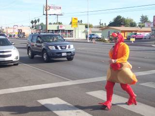 Metro Police officer Michael Lemley dresses in a turkey suit to cross Charleston Boulevard in efforts to promote traffic safety, Nov. 22, 2011.