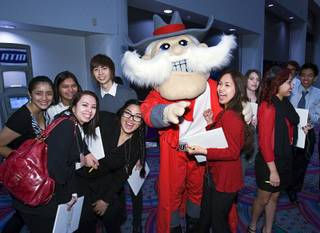 UNLV mascot Hey Reb poses with Chesley Estrada of East Career and Technical Academy and other students before the 2011 Las Vegas Sun Youth Forum at the Las Vegas Convention Center on Tuesday, Nov. 22, 2011. Nearly 1,000 students from 52 schools participated in the annual event.
