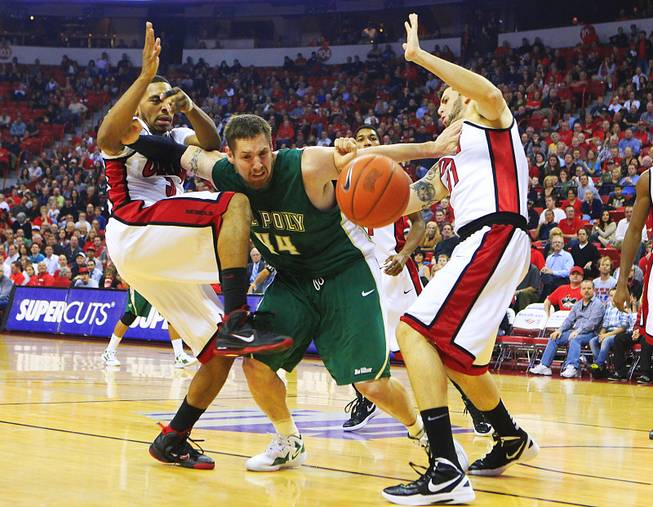 Cal Poly center Will Donahue pushes away UNLV guard Anthony Marshall, left, and forward Carlos Lopez during their game Tuesday, Nov. 22, 2011 at the Thomas & Mack Center.