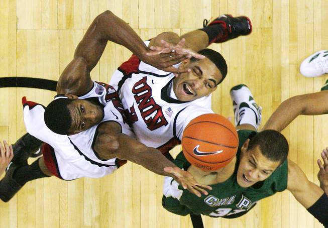 UNLV's Mike Moser, left, and Anthony Marshall grab a rebound from Cal Poly forward David Hanson during their game Tuesday, Nov. 22, 2011 at the Thomas & Mack Center. UNLV won the game 75-52.