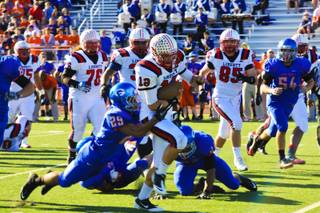 Defensive back Kai Nacua, #12 Liberty, gets taken down by Justin Sweet, #29 of Gorman, during their state semi-final game Saturday Nov. 26, 2011. Gorman takes down Liberty 56-34 and advances on to face Northern Nevada's Reed High in Reno.